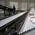 usps-parcels-on-roller-conveyor