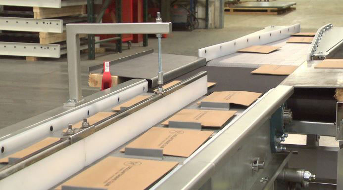 Product merges on conveyor