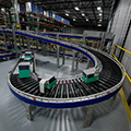 knipper_case_study_order_fulfillment_boxes_on_conveyor_curve-thumb