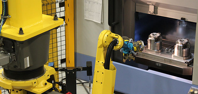 Industrial machine tending robot in action
