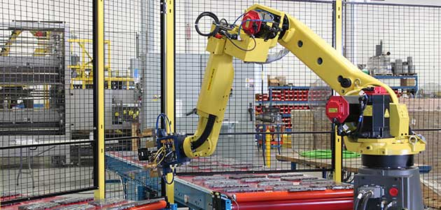 Robotic machine tending system for automotive parts
