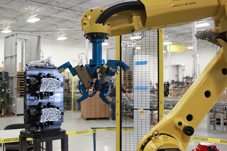 Robotic Machine Tending   Industrial Robotics   Bastian Solutions